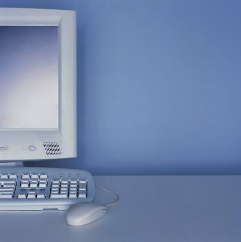 Computer Monitor and Keyboard on Desk